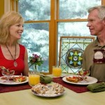 Couple sitting down to the best breakfast in Green Lake, Wisconsin at Miller's Daughter B&B